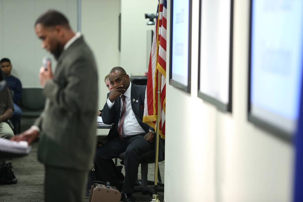 Hope For Prisoners CEO Jon Ponder listens to a program graduate at the Las Vegas Metropolitan Police Department headquarters in Las Vegas, Friday, Jan. 11, 2019. Erik Verduzco Las Vegas Review-Jou ...
