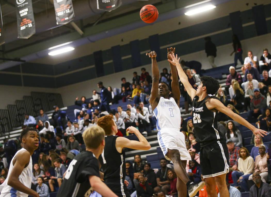 Centennial's Jairus Dickson (1) shoots past Palo Verde's Sebastian Bejaoui (20) during the first half of a basketball game at Centennial Hills High School in Las Vegas on Friday, Jan. 11, 2019. Ch ...