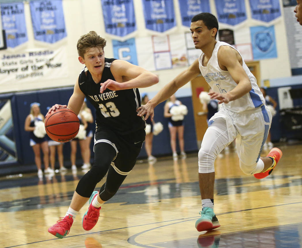 Palo Verde's Kade Madsen (23) drives the ball against Centennial's Savio Rivera (4) during the second half of a basketball game at Centennial Hills High School in Las Vegas on Friday, Jan. 11, 201 ...