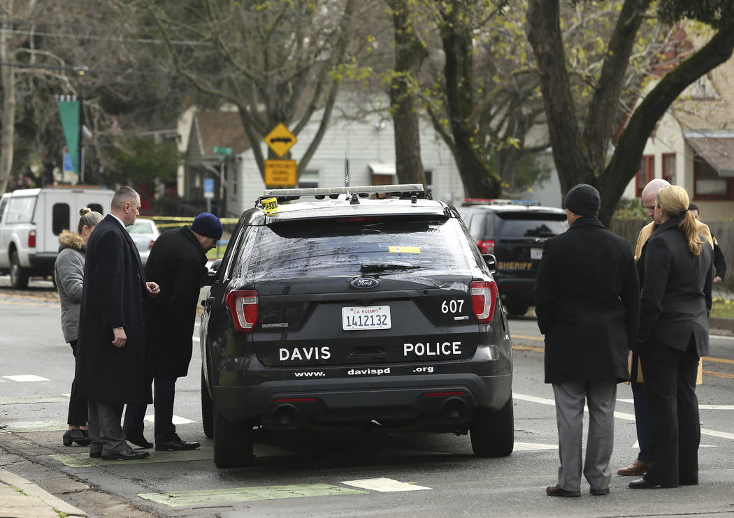 Authorities inspect the patrol vehicle driven by Davis Police Officer Natalie Corona, Friday, Jan. 11, 2019, in Davis, Calif. (AP Photo/Rich Pedroncelli)