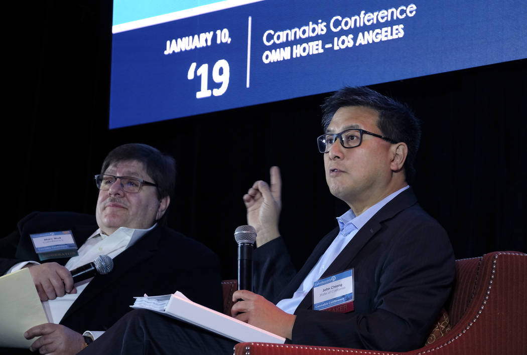Former California State Treasurer John Chiang, right, answers questions from moderator Marc Wolf, left, at the CohnReznick Cannabis Conference 2019 in downtown Los Angeles, Thursday, Jan. 10, 2019 ...