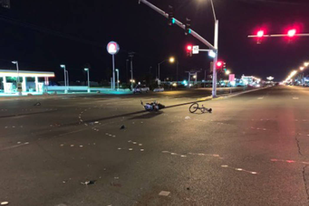 A bicyclist died early Saturday after he was struck by a suspected impaired motorcyclist and thrown into a vehicle east of downtown Las Vegas. (@LVMPD_Traffic/Twitter)