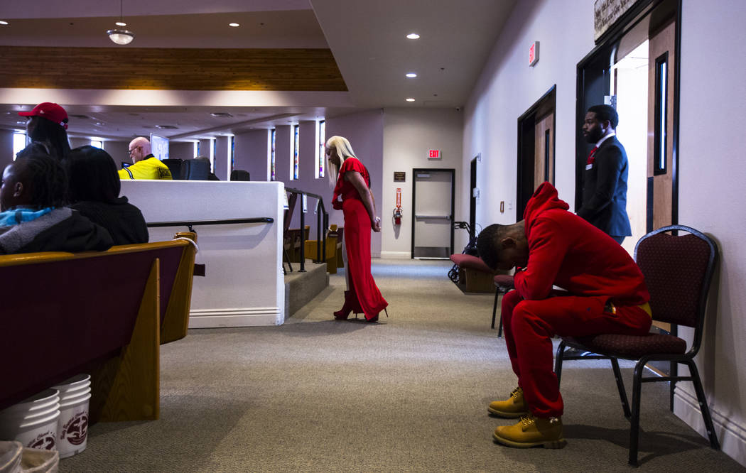 People bow their heads in prayer during a memorial service for Kwavon'tia Thomas at Unity Baptist Church in Las Vegas on Saturday, Jan. 12, 2019. Thomas, 18, died in a Christmas Eve shooting in No ...