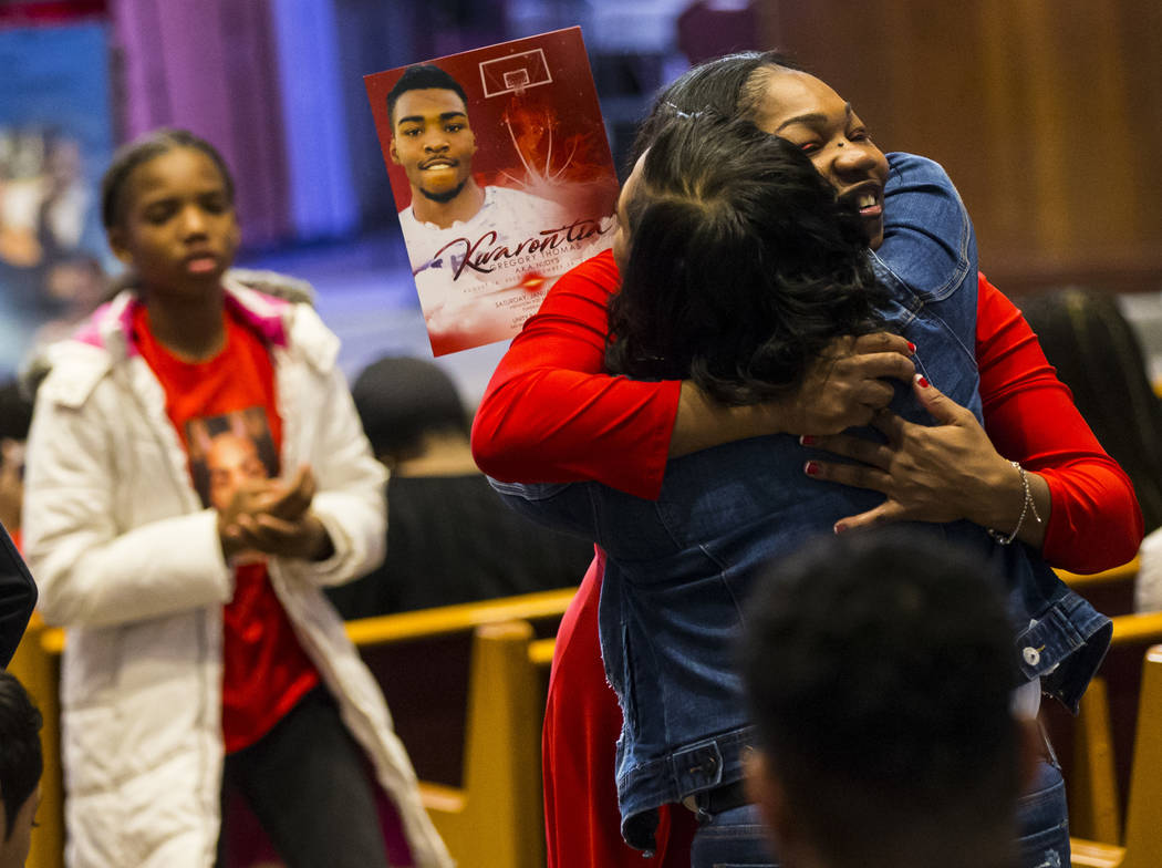 Timika Thomas, right, is embraced before the start of memorial services for her son, Kwavon'tia Thomas, at Unity Baptist Church in Las Vegas on Saturday, Jan. 12, 2019. Thomas, 18, died in a Chris ...