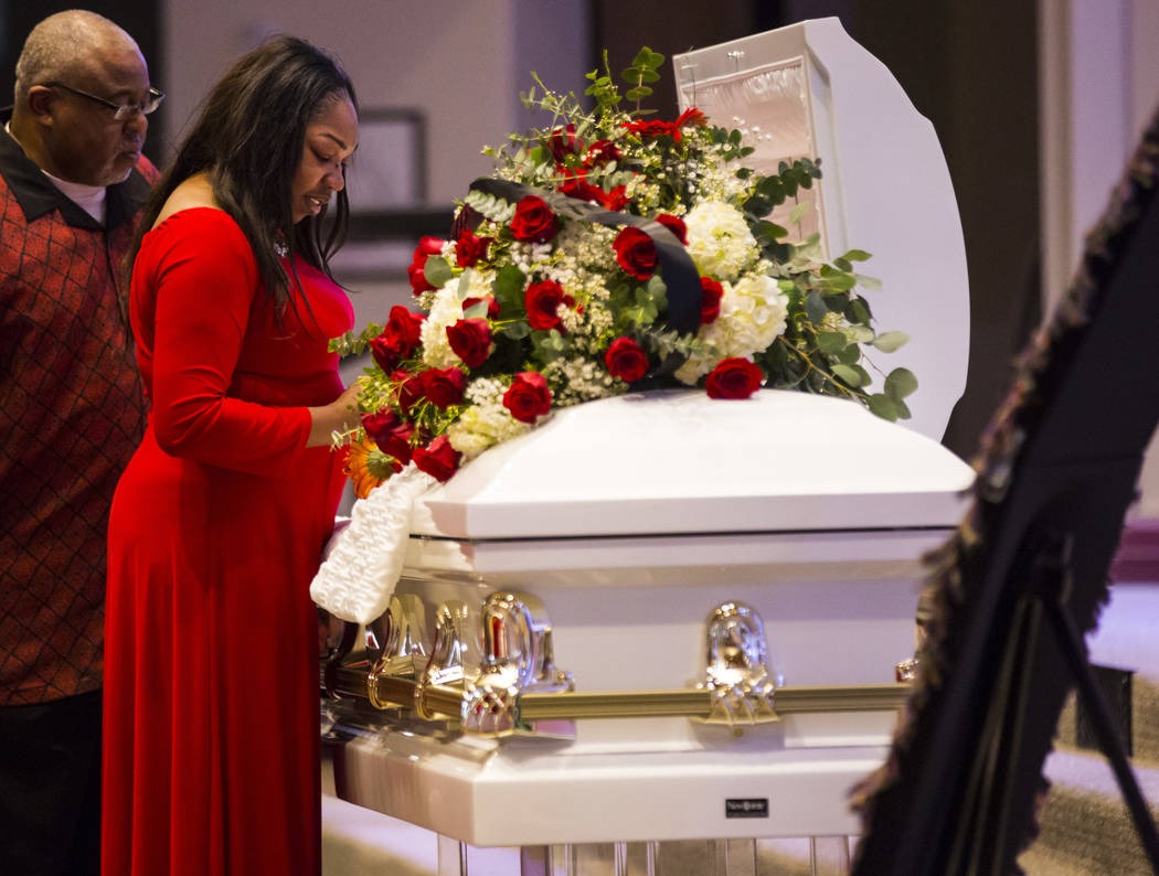 Timika Thomas looks at her son, Kwavon'tia Thomas, during his memorial service at Unity Baptist Church in Las Vegas on Saturday, Jan. 12, 2019. Thomas, 18, died in a Christmas Eve shooting in Nort ...