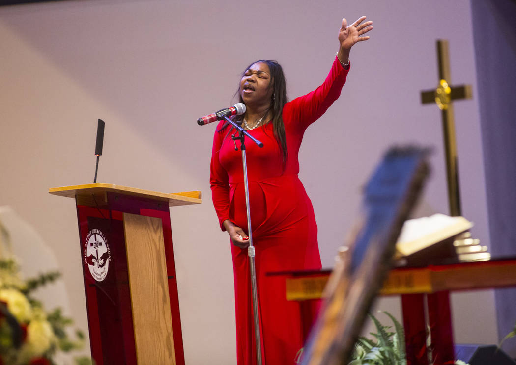 Timika Thomas sings in memory of her son, Kwavon'tia Thomas, at his memorial service at Unity Baptist Church in Las Vegas on Saturday, Jan. 12, 2019. Thomas, 18, died in a Christmas Eve shooting i ...