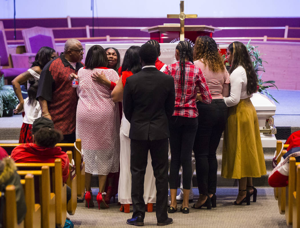 Timika Thomas, center left, is consoled during the memorial service for her son, Kwavon'tia Thomas, at Unity Baptist Church in Las Vegas on Saturday, Jan. 12, 2019. Thomas, 18, died in a Christmas ...