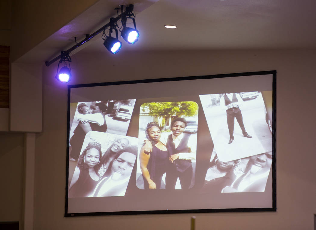 Photos are displayed in a slideshow during a memorial service for Kwavon'tia Thomas at Unity Baptist Church in Las Vegas on Saturday, Jan. 12, 2019. Thomas, 18, died in a Christmas Eve shooting in ...