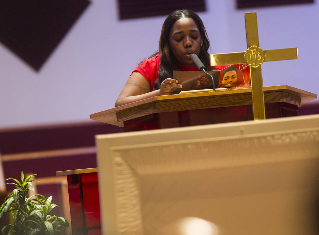 Tatiana Valentine reads the obituary of Kwavon'tia Thomas during his memorial service at Unity Baptist Church in Las Vegas on Saturday, Jan. 12, 2019. Thomas, 18, died in a Christmas Eve shooting ...