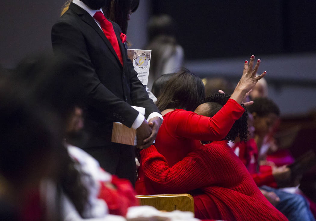 Timika Thomas, center, is consoled during the memorial service for her son, Kwavon'tia Thomas, at Unity Baptist Church in Las Vegas on Saturday, Jan. 12, 2019. Thomas, 18, died in a Christmas Eve ...