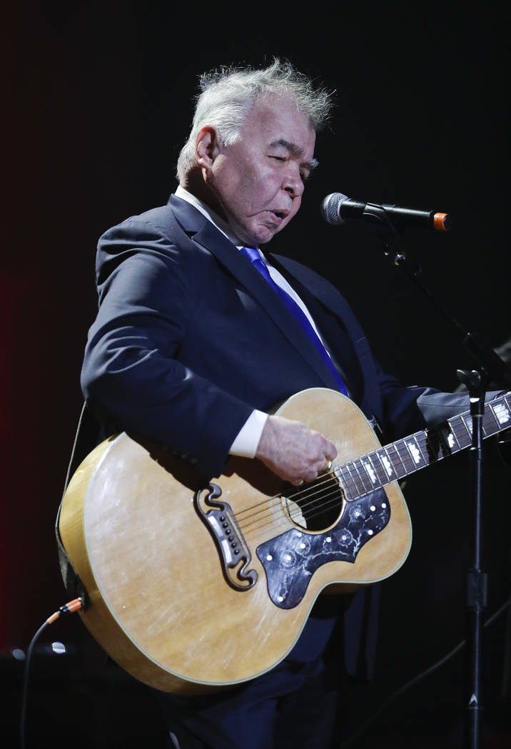 FILE - In this Wednesday, Sept. 13, 2017 file photo, John Prine performs during the Americana Honors and Awards show in Nashville, Tenn. Missy Elliott is making history as the first female rapper ...