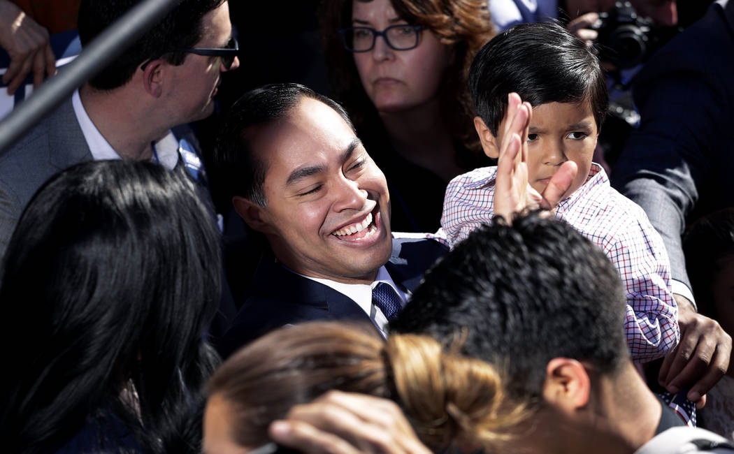 Former San Antonio Mayor and Housing and Urban Development Secretary Julian Castro, center, greets supporters during an event where he announced his decision to seek the 2020 Democratic presidenti ...