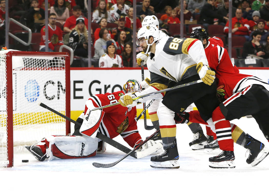 Vegas Golden Knights right wing Alex Tuch (89) scores a goal past Chicago Blackhawks goaltender Collin Delia (60) during the second period of an NHL hockey game Saturday, Jan. 12, 2019, in Chicago ...