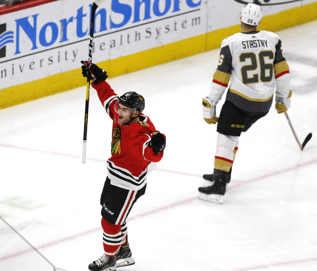Chicago Blackhawks left wing Alex DeBrincat (12) celebrates after his goal against the Vegas Golden Knights, during the first period of an NHL hockey game Saturday, Jan. 12, 2019, in Chicago. (AP ...