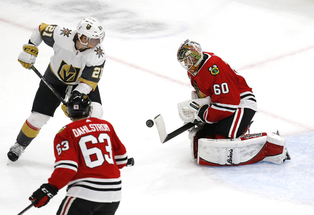 Chicago Blackhawks goaltender Collin Delia (60) makes a save on a shot by Vegas Golden Knights center Cody Eakin (21) during the first period of an NHL hockey game Saturday, Jan. 12, 2019, in Chic ...