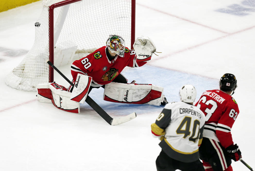 Vegas Golden Knights center Ryan Carpenter (40) scores a goal past Chicago Blackhawks goaltender Collin Delia (60) during the second period of an NHL hockey game Saturday, Jan. 12, 2019, in Chicag ...