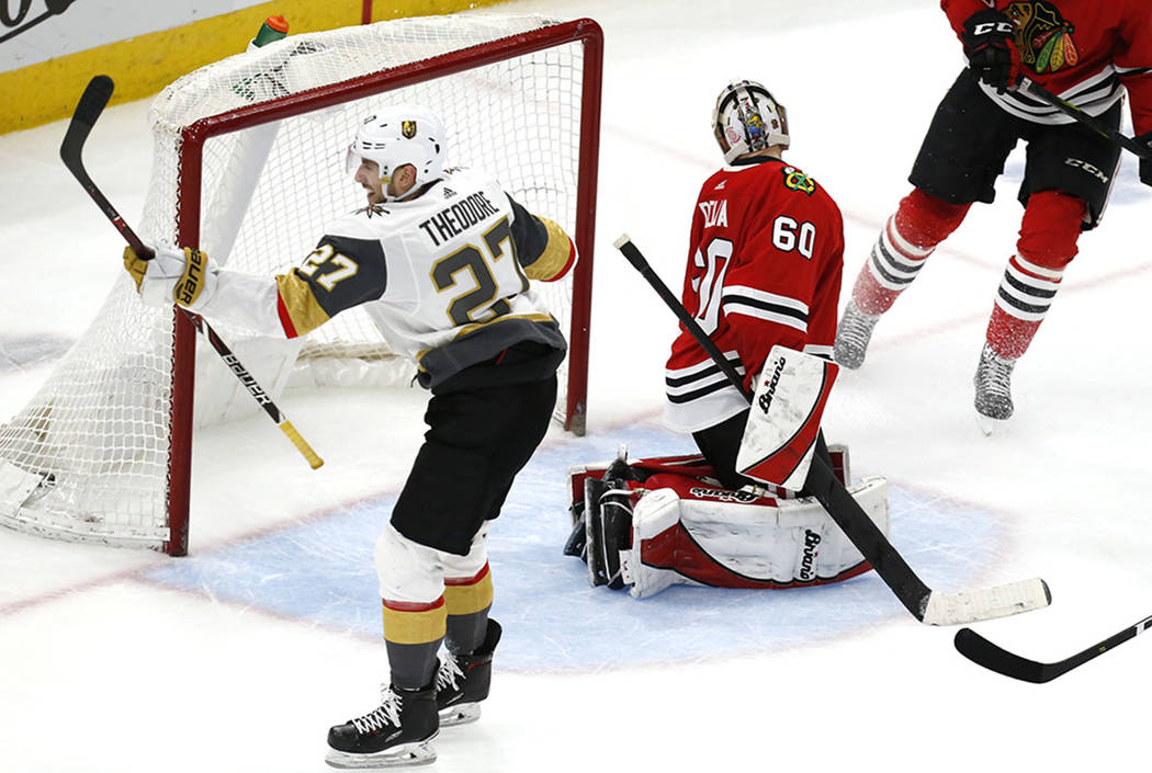 Chicago Blackhawks goaltender Collin Delia (60) looks back at a goal scored by Vegas Golden Knights defenseman Shea Theodore (27) during the overtime period of an NHL hockey game Saturday, Jan. 12 ...
