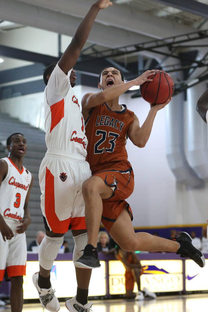Legacy's Andrew Garcia (23) goes up for a shot against Chaparral's Meshach Hawkins (1) in the boy's basketball game at Durango High School in Las Vegas, Saturday, Jan. 12, 2019. Erik Verduzco Las ...