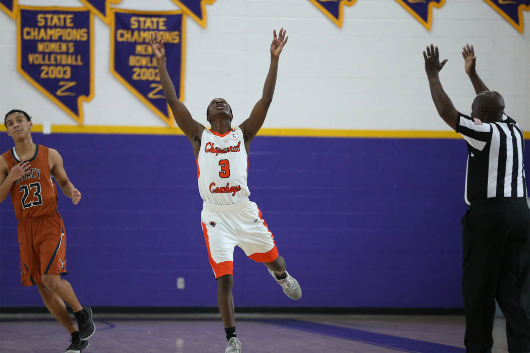 Chaparral's Elijah Briggs (3) reacts after making a three-pot-shot against Legacy during the fourth quarter of the boy's basketball game at Durango High School in Las Vegas, Saturday, Jan. 12, 20 ...