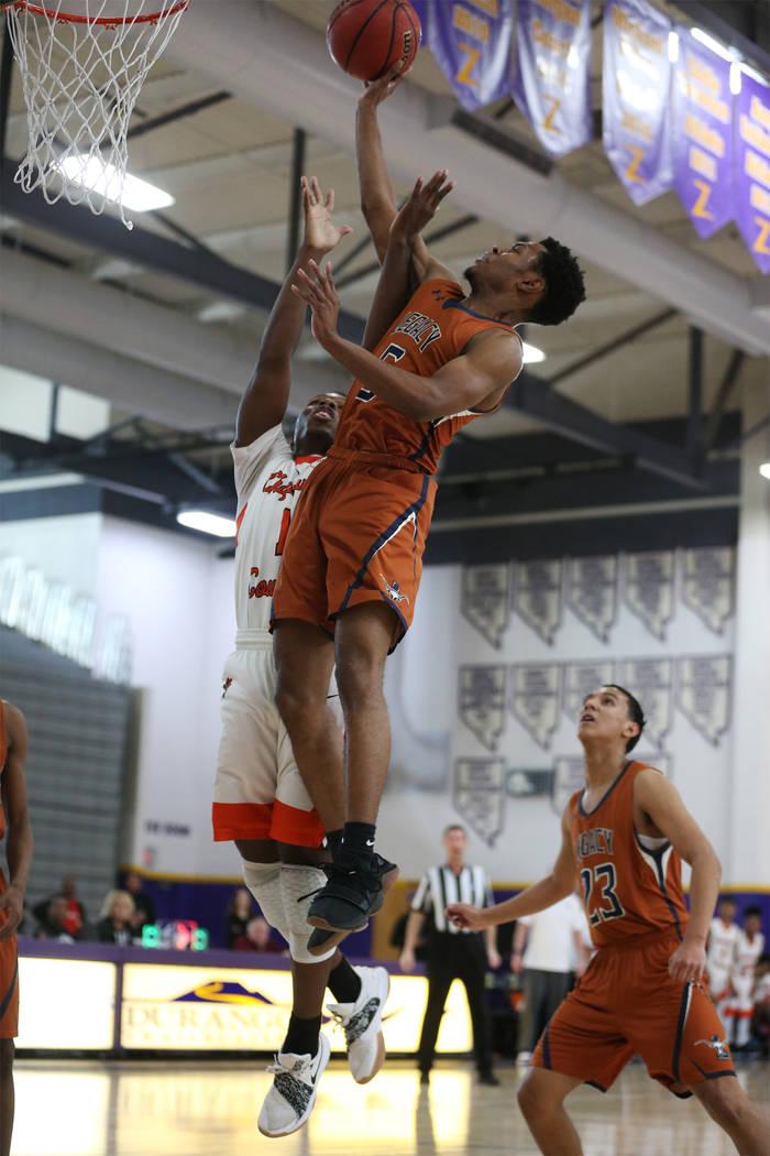Legacy's Jalen Johnson (5) goes up for a shot against Chaparral's Meshach Hawkins (1) in the boy's basketball game at Durango High School in Las Vegas, Saturday, Jan. 12, 2019. Erik Verduzco Las V ...