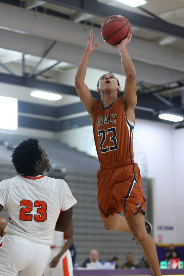 Legacy's Andrew Garcia (23) goes up for a shot against Chaparral in the boy's basketball game at Durango High School in Las Vegas, Saturday, Jan. 12, 2019. Erik Verduzco Las Vegas Review-Journal @ ...
