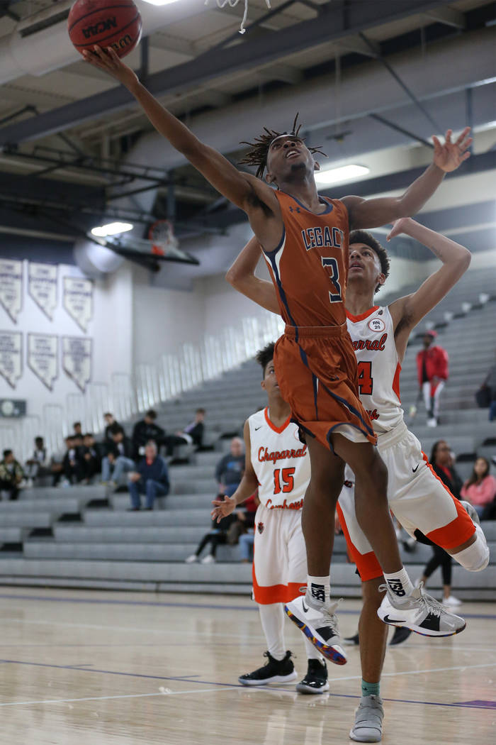 Legacy's Rayshon Funches (3) takes a shot under pressure from Chaparral's Sameal Anderson 24) in the boy's basketball game at Durango High School in Las Vegas, Saturday, Jan. 12, 2019. Erik Verduz ...