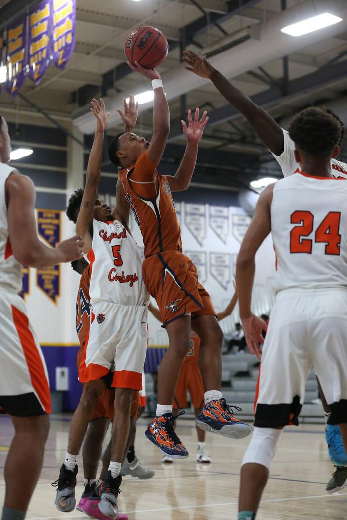 Legacy's Emmanuel Austin (10) takes a shot under pressure from Chaparral's Miles Lewis-Disroe (5) in the boy's basketball game at Durango High School in Las Vegas, Saturday, Jan. 12, 2019. Erik Ve ...