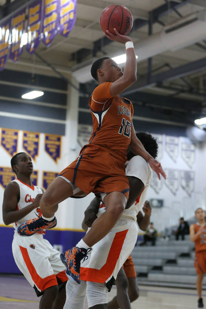Legacy's Emmanuel Austin (10) takes a shot against Chaparral before getting called for a charge in the boy's basketball game at Durango High School in Las Vegas, Saturday, Jan. 12, 2019. Erik Verd ...