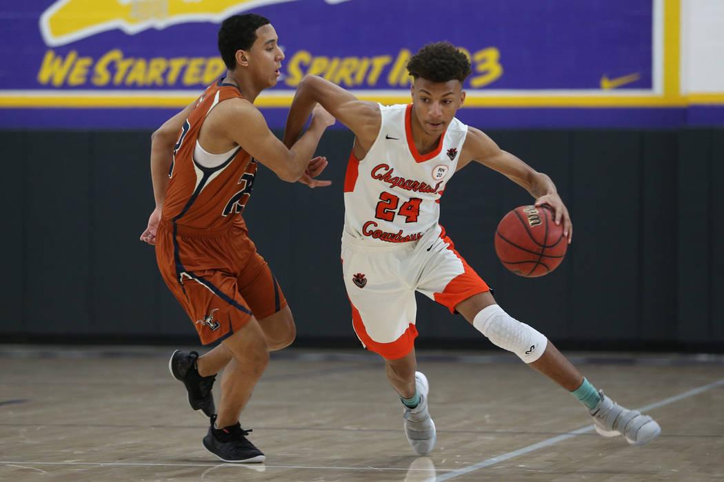 Chaparral's Sameal Anderson (24) dribbles the ball past Legacy's Andrew Garcia (23) in the boy's basketball game at Durango High School in Las Vegas, Saturday, Jan. 12, 2019. Erik Verduzco Las Veg ...