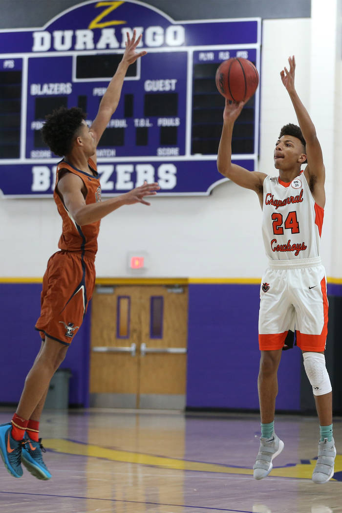 Chaparral's Sameal Anderson (24) takes a shot under pressure from Legacy's Shamir Chambers (4) in the boy's basketball game at Durango High School in Las Vegas, Saturday, Jan. 12, 2019. Erik Verdu ...