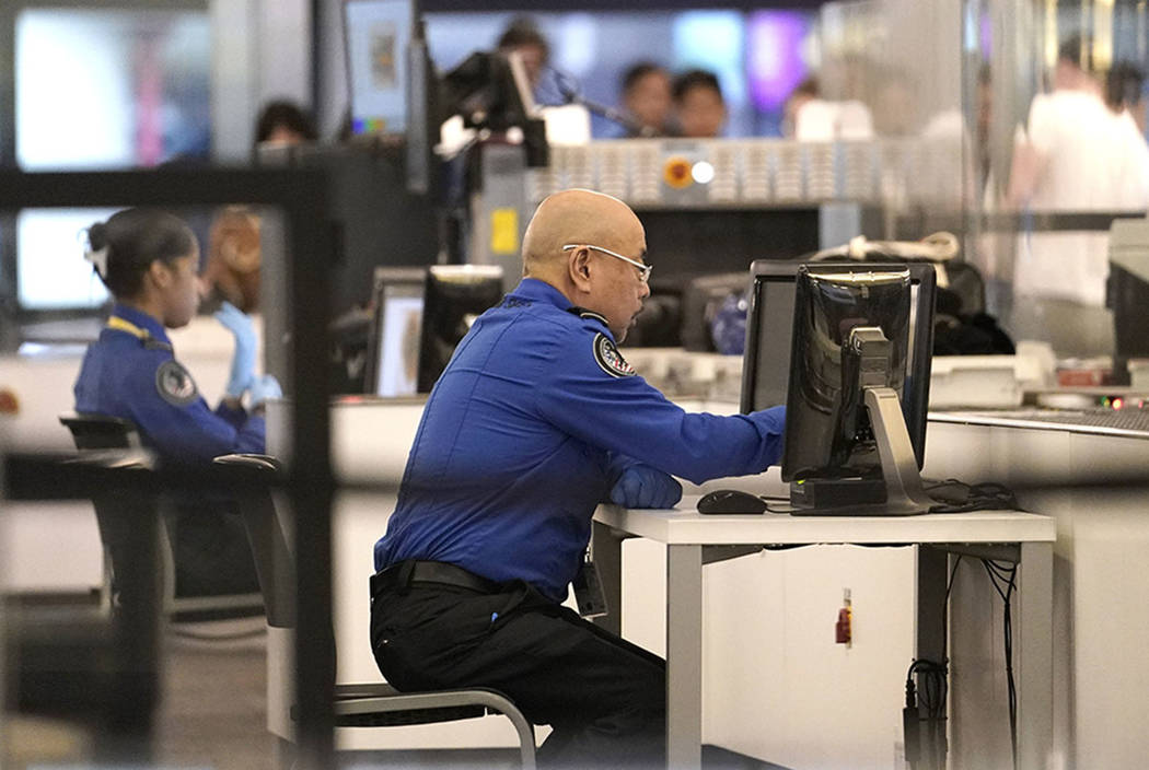 Transportation Security Administration officials work at the entrance to a concourse at San Francisco International Airport, Tuesday, Jan. 8, 2019, in San Francisco. (AP Photo/David J. Phillip)
