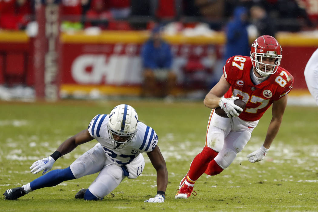 Kansas City Chiefs tight end Travis Kelce (87) carries the ball during the first half of an NFL divisional football playoff game against the Indianapolis Colts in Kansas City, Mo., Saturday, Jan. ...