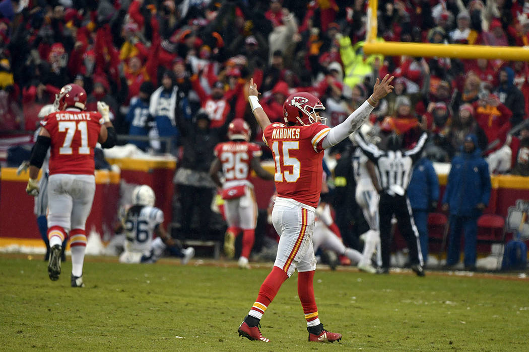 Kansas City Chiefs quarterback Patrick Mahomes (15) celebrates a touchdown by wide receiver Tyreek Hill (10) during the first half of an NFL divisional football playoff game against the Indianapol ...