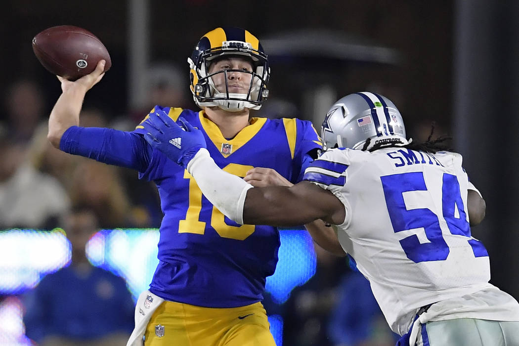 Los Angeles Rams quarterback Jared Goff passes under pressure from Dallas Cowboys middle linebacker Jaylon Smith during the first half in an NFL divisional football playoff game Saturday, Jan. 12, ...