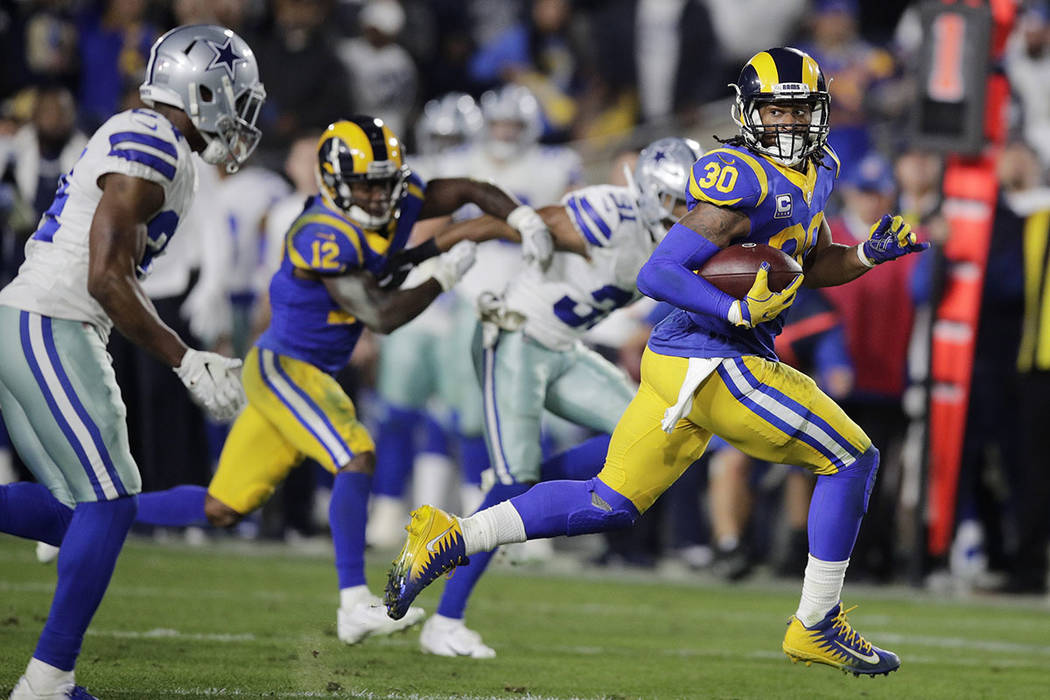 c5d669ebf Los Angeles Rams running back Todd Gurley scores past Dallas Cowboys  cornerback Chidobe Awuzie during the