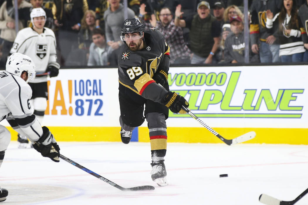 Golden Knights right wing Alex Tuch (89) shoots to score an empty net goal against the Los Angeles Kings during the third period of an NHL hockey game at T-Mobile Arena in Las Vegas on Tuesday, Ja ...