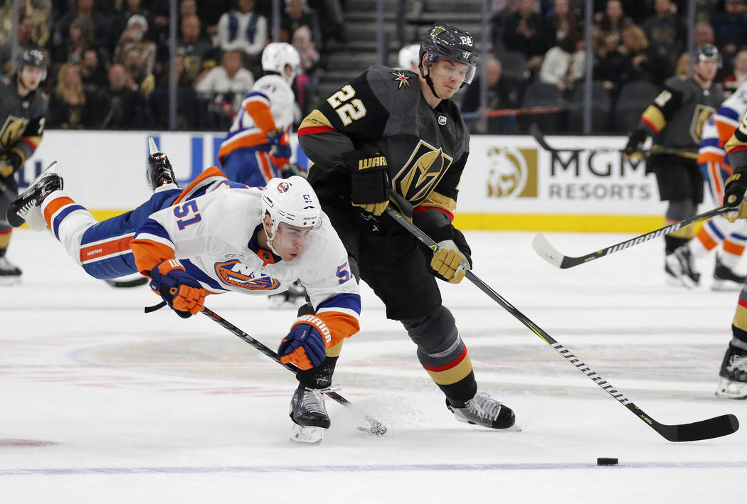 New York Islanders center Valtteri Filppula (51) trips beside Vegas Golden Knights defenseman Nick Holden (22) during the third period of an NHL hockey game Thursday, Dec. 20, 2018, in Las Vegas. ...