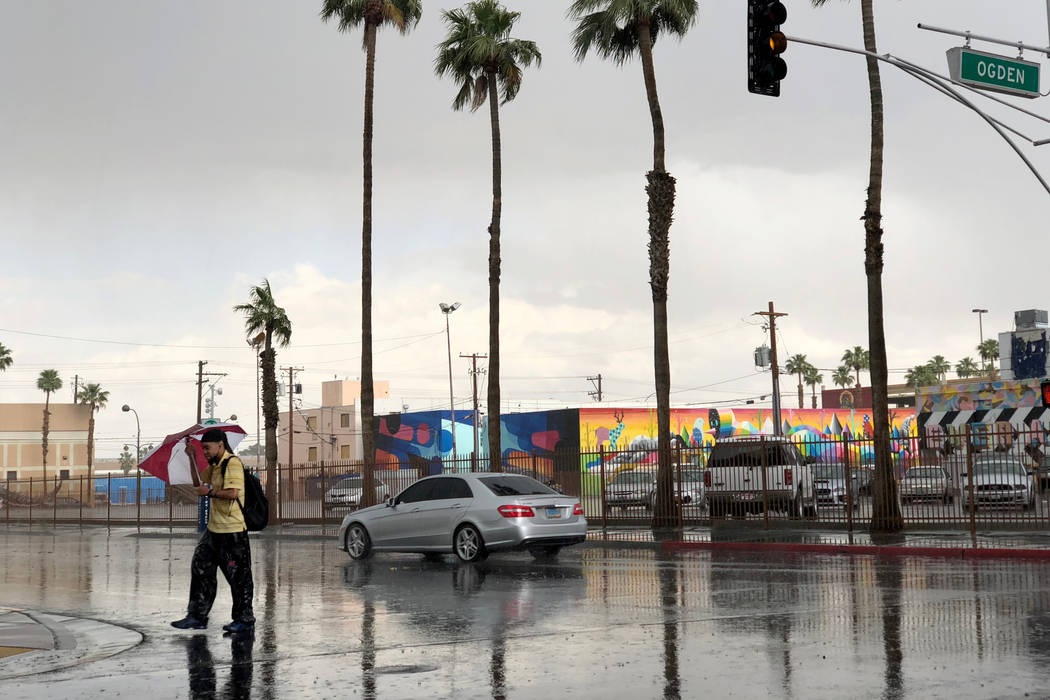 A pedestrian who declined to give his name crosses Sixth Street at Ogden Avenue in light rain in downtown Las Vegas Tuesday, May 1, 2018. K.M. Cannon Las Vegas Review-Journal @KMCannonPhoto