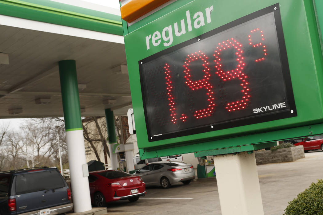 FILE - In this Tuesday, Jan. 8, 2019, file photo drivers fill up at the BP station on Prince Avenue in Athens, Ga. The average U.S. price of regular-grade gasoline has dropped 12 cents a gallon (3 ...