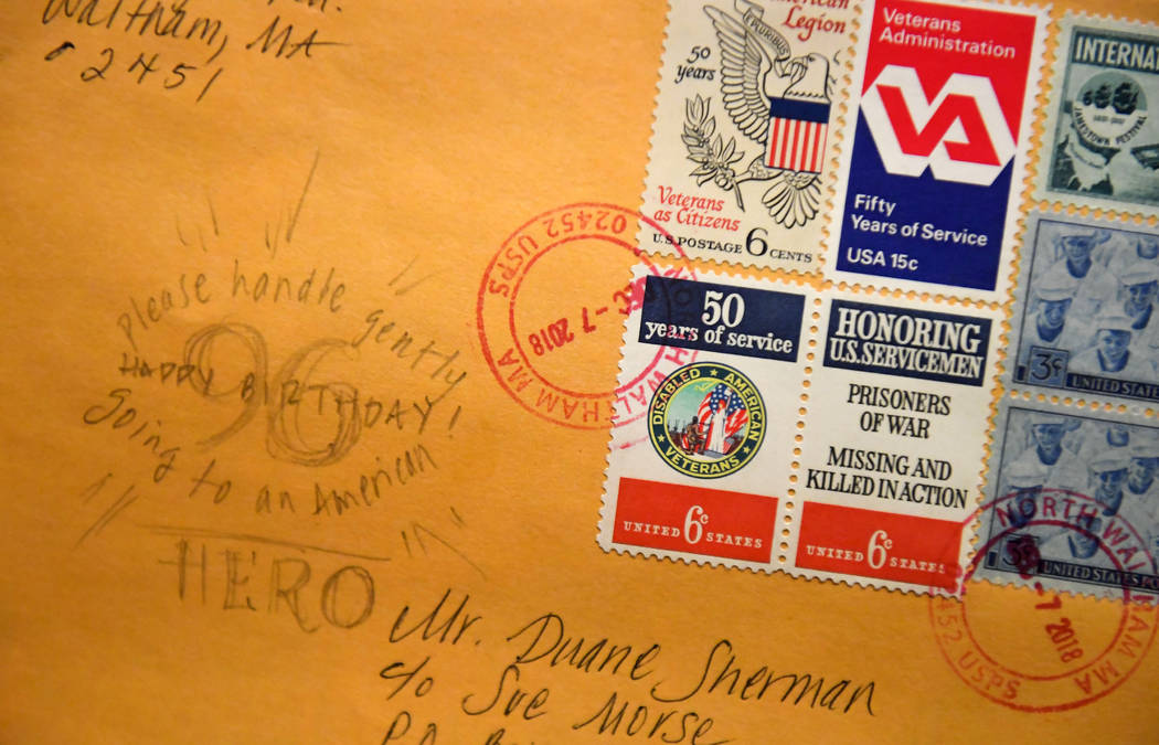 """In this Tuesday, Jan. 8, 2019 photo, a handwritten note on one of the 50,000 birthday cards received by Duane Sherman, 96, reads """"Please handle gently, going to an American Hero"""" display ..."""