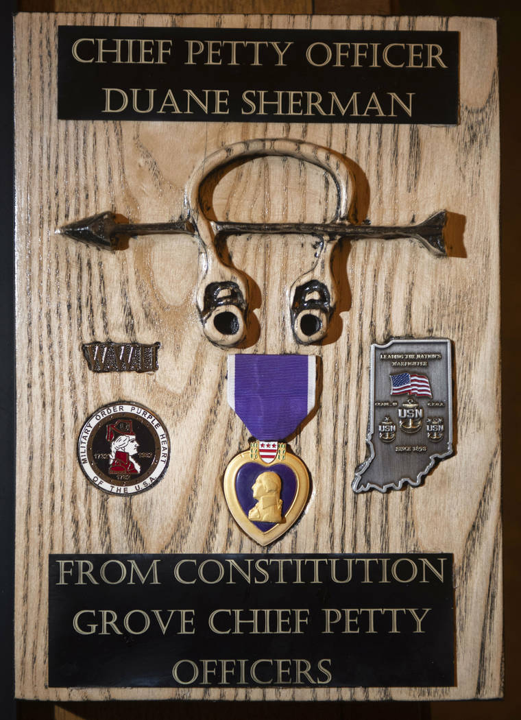 This Tuesday, Jan. 8, 2019 photo shows a gift carved from a piece of wood from the USS Constitution, one of many received by Duane Sherman after his daughter's social media request for birthday ca ...