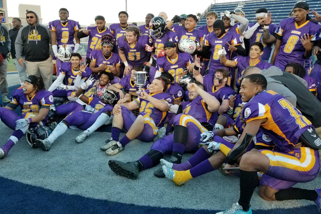 North players celebrate with the trophy after defeating the South squad 30-26 to win the 47th West Charleston Lions Charity all-star game on Sunday, Jan. 13, 2019 at Bishop Gorman. (Damon Seiters/ ...