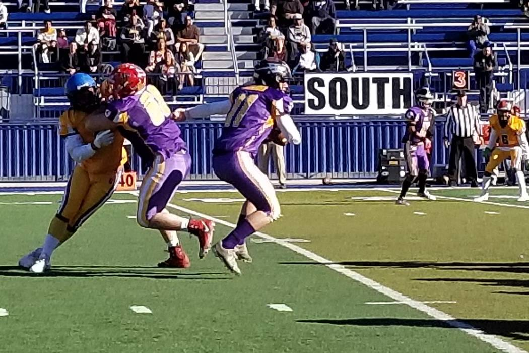 The North's Sagan Gronauer (11) of Faith Lutheran avoids the pass rush during the 47th West Charleston Lions Charity all-star game on Sunday, Jan. 13, 2019 at Bishop Gorman. (Damon Seiters/Las Veg ...