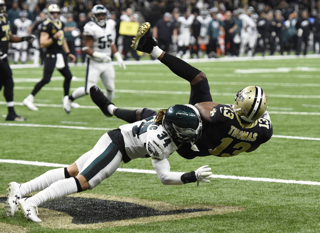New Orleans Saints wide receiver Michael Thomas (13) pulls in a touchdown reception against Philadelphia Eagles cornerback Cre'von LeBlanc (34) in the second half of an NFL divisional playoff foot ...