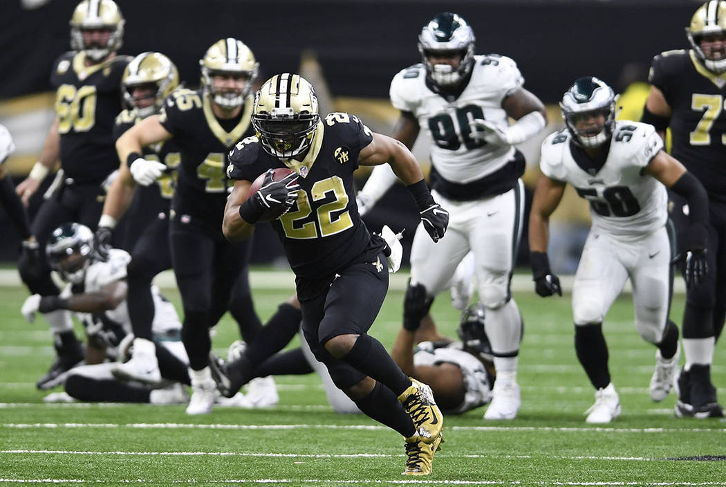 New Orleans Saints running back Mark Ingram (22) runs against the Philadelphia Eagles in the second half of an NFL divisional playoff football game in New Orleans, Sunday, Jan. 13, 2019. (AP Photo ...