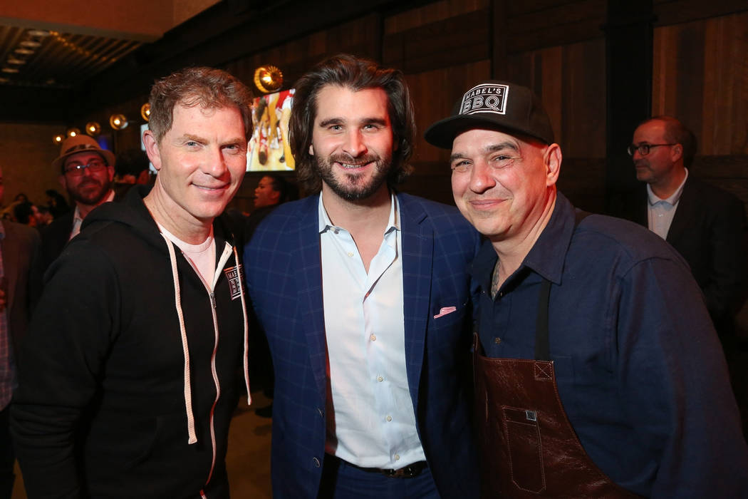 Celebrity chef Bobby Flay, left, and Palms General Manager Jon Gray, center, attend the opening party for Mabel's BBQ with chef/owner Michael Symon. (Clint Jenkins)