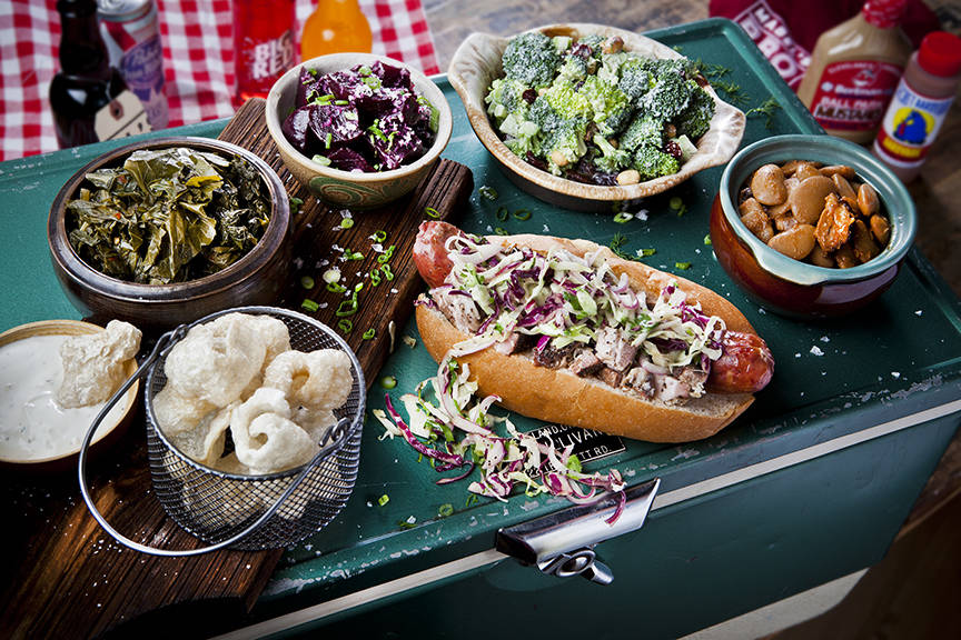 The Polish Girl kielbasa sandwich is flanked by several sides. (Clint Jenkins)