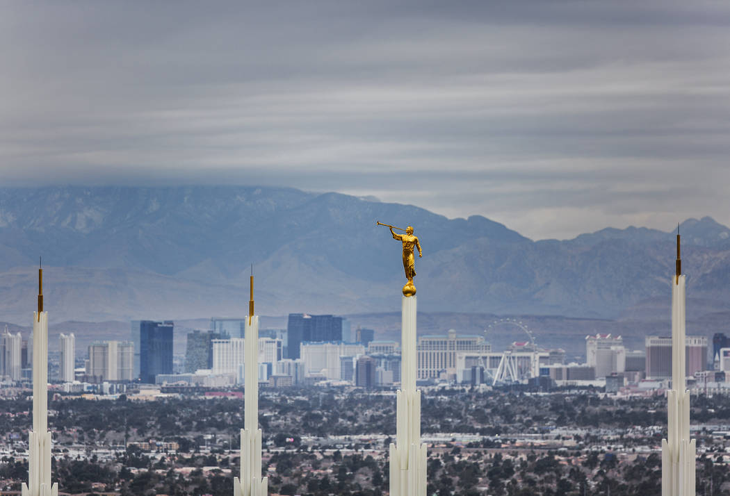 Dark clouds move across the skyline highlighted by the spires of the Las Vegas Nevada Temple on Monday, Jan. 14, 2019, in Las Vegas. Clouds, rain and snow are expected in parts of the Las Vegas Va ...