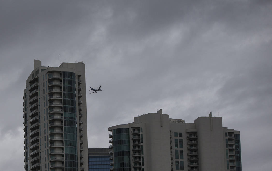 A plane passes through dark clouds over The Strip on Monday, Jan. 14, 2019, in Las Vegas. Clouds, rain and snow are expected in parts of the Las Vegas Valley this week. Benjamin Hager Las Vegas Re ...
