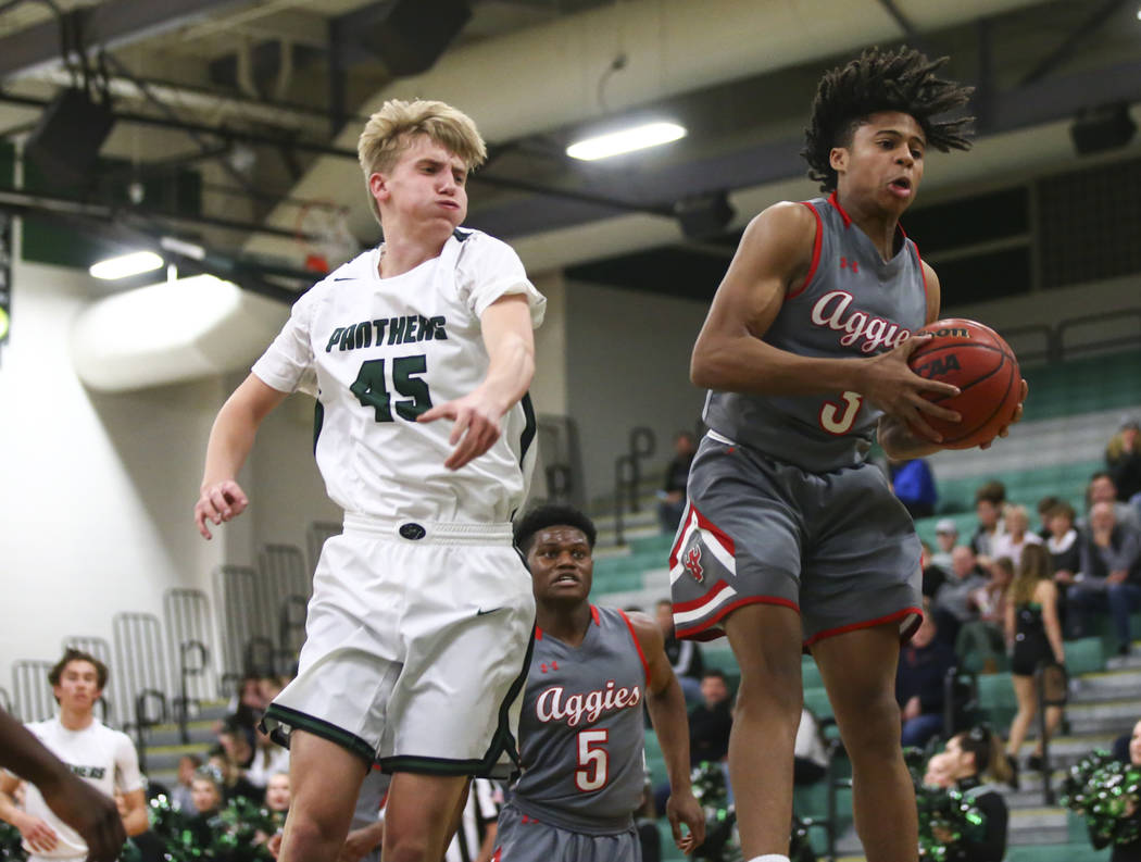 Arbor View's guard Ameer Muhammad (3) gets a rebound over Palo Verde's Harlan Nichols (45) during a basketball game at Palo Verde High School in Las Vegas on Thursday, Jan. 17, 2019. Chase Stevens ...